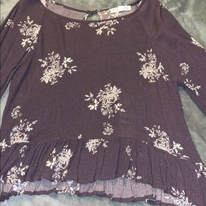 Purple blouse with white flowers